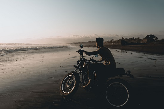 motorcycle-on-wet-beach-sands